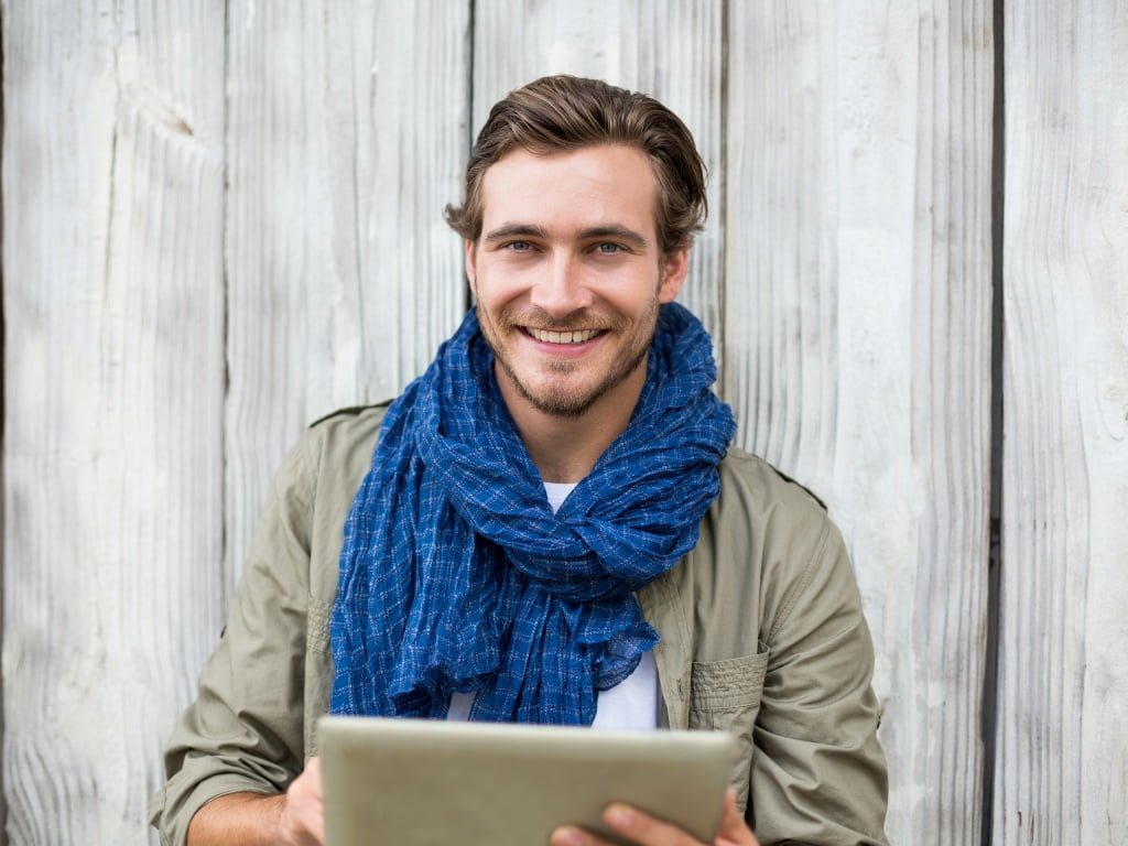 Man in scarf looking happy